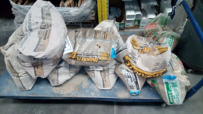 busted cement bags and sand bags for sale for $.50
