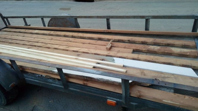 A trailer of lumber salvaged from a roof rebuild. 2 x 6 x 14 dimensional lumber plus more