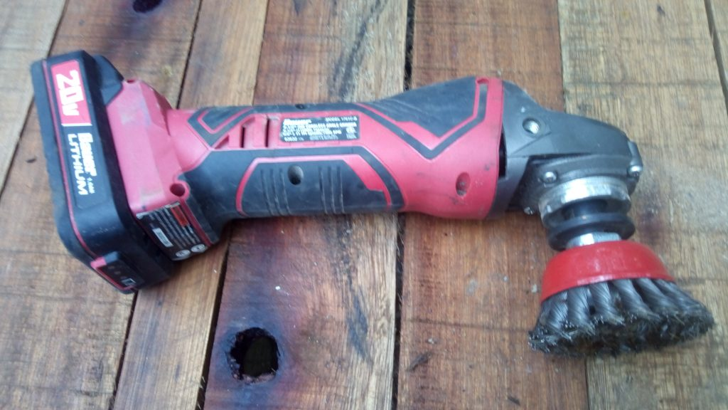 Cordless angle grinder with wire wheel attachment