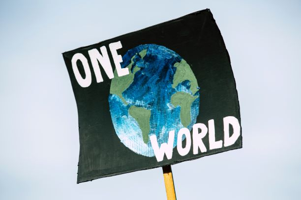 one world save the earth sign