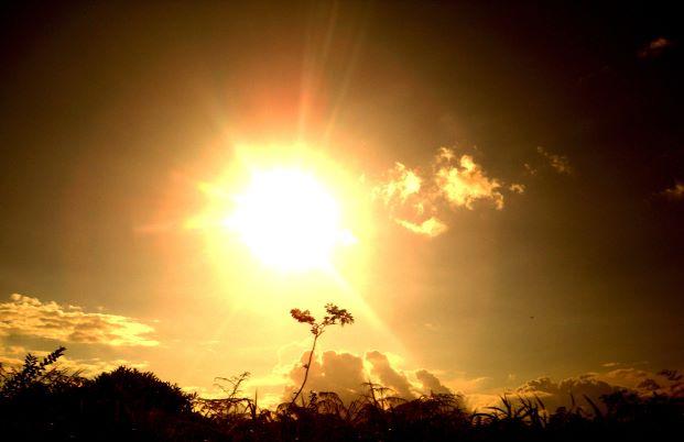 The sun bombarding the earth with solar energy